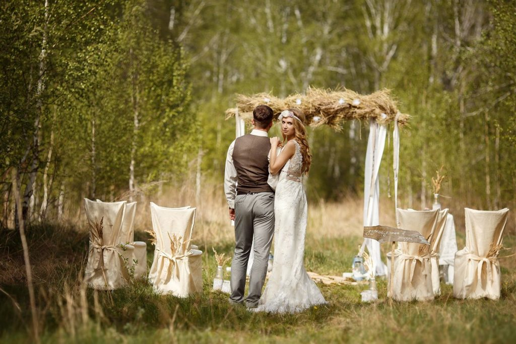 Images of the newlyweds at an outdoor wedding